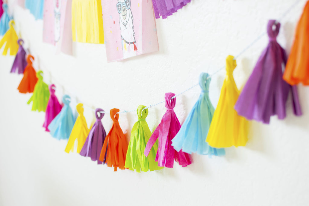 How To Throw a Colorful Llama Party - DIY Lllama Party Garlands using paper napkins